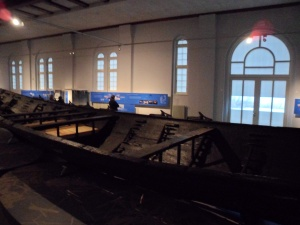 The forward part of the Nydam ship from above, taken in Schloss Gottorf, Schleswig, Germany.  Note the pale reconstructed deck planks contrasted against the blackened oak of the original find.