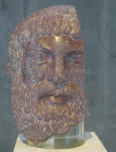 Life-sized head of a bearded man carved of smooth stone