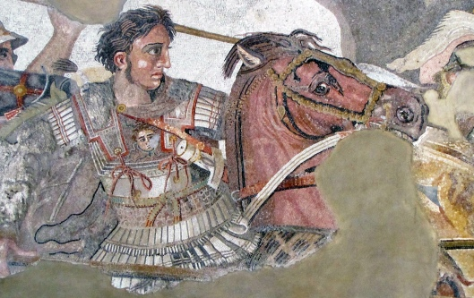 A mosaic of Alexander the Great on horseback with a lance in his right hand wearing a white cuirass with shoulder flaps and skirts of narrow flaps at the shoulders and waist