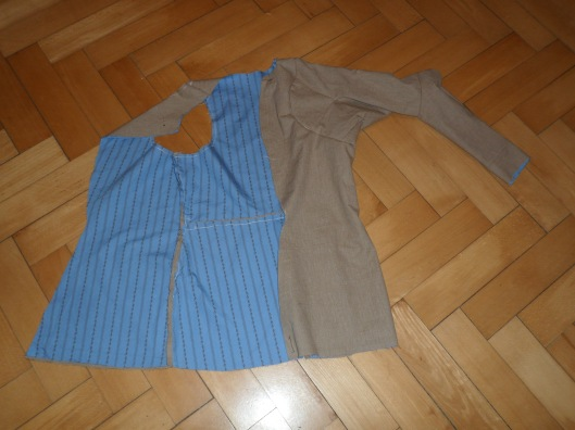 A doublet of coarse cotton lined with fine, thin striped cotton with one arm attached and the other missing
