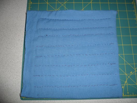 Right side (ie. outside, blue side) of test piece, selvedge at left, thickest padding at top, thinnest padding at bottom