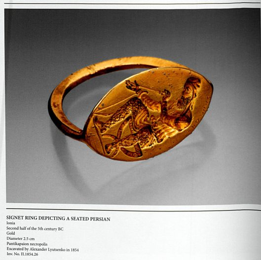 A gold signet ring with an oblong face