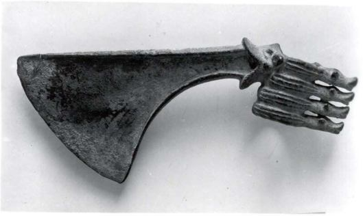 An axehead with its blade emerging from the mouth of a duck attached to its socket
