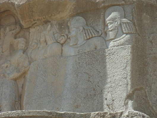 Three figures on the right.  Under the rightmost figure traces of a coiled snake are visible.  In Neo-Elamite art, kinds and gods often appear seated on a coiled snake.  Photo by Sean Manning, May 2016.