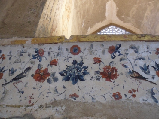 A wall painting of small birds with long, narrow beaks