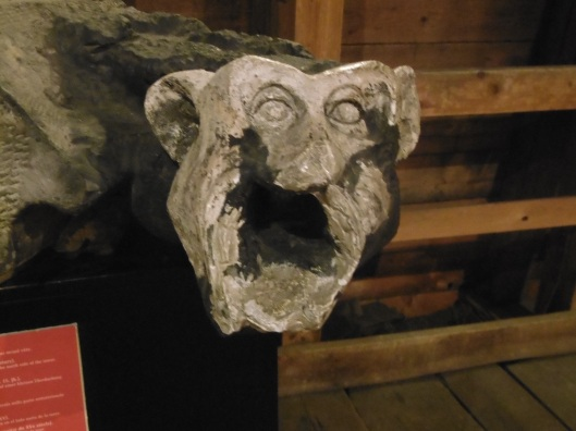 One of the original gargoyles from the Gunpowder Tower, Prague, now on display inside the attic of the tower.