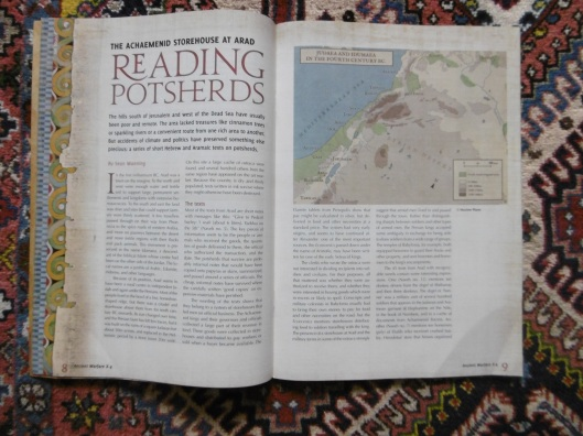 A photograph of an issue of a glossy magazine against an Qashqai carpet