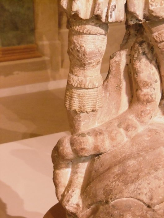 The leg of a sandstone sculpture of St. George and the dragon
