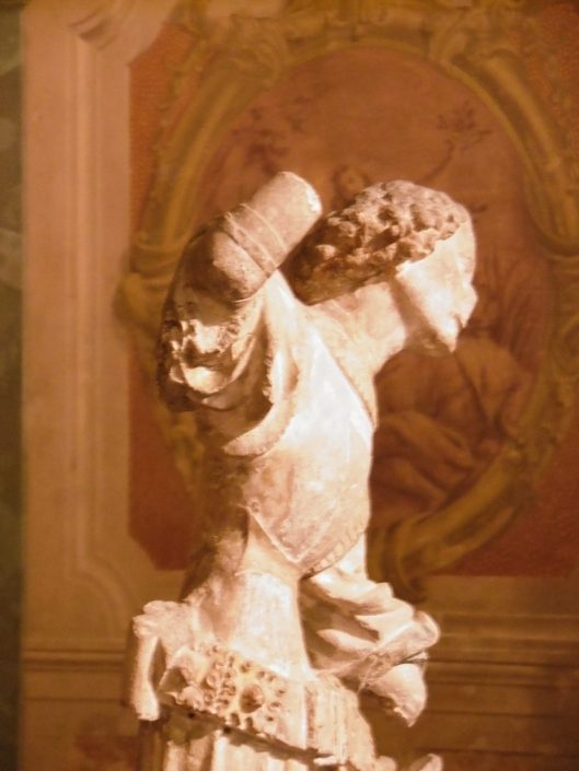Side view of the chest of a limestone statue of St. George